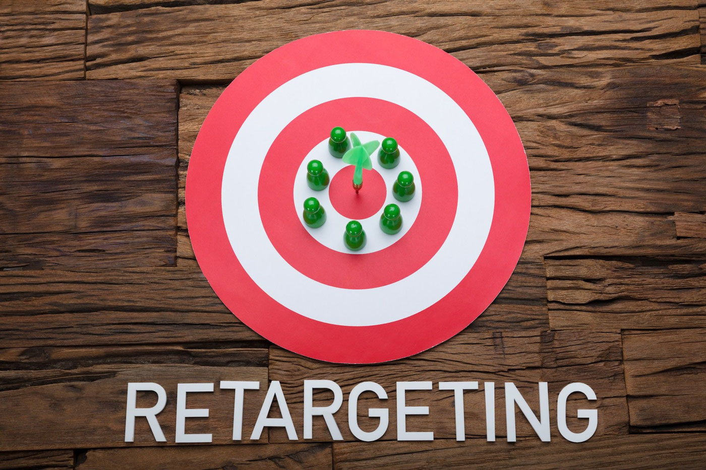 Arrow And Pawn Figurines On Dartboard With Retargeting Text