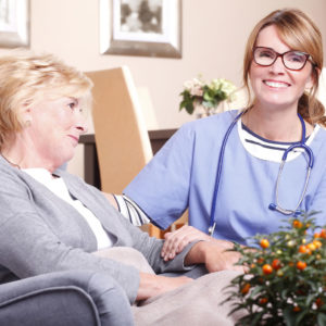 Happy nurse and patient